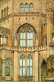 Old gothic building. Exterior of old brick building with Gothic style windows Royalty Free Stock Photo