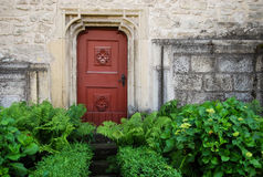 Old gothic door in the garden stock photos