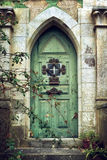 Old Gothic Door. In romantic style with peeling green paint royalty free stock image