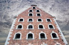 Old gothic house in Torun, dark sky Royalty Free Stock Photos