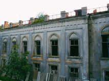 The old gothic palace of the nobleman Goroholsky in the village Chervone. The castle is now a monastery. And part of the palace in an abandoned state stock photography