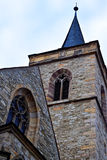 The old Gothic stone Church. With a tower and stained glass Windows in the old town Royalty Free Stock Photo
