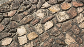 Old Gothic stone wall of rubble. Orange Stock Images