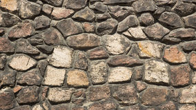 Old Gothic stone wall of rubble. Orange Royalty Free Stock Photography