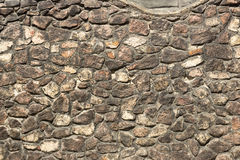 Old Gothic stone wall of rubble. Orange Royalty Free Stock Photo