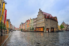 Old gothic street in bavarian town by Munich, Germany. Old gothic street in bavarian town Landshut near Munich, Germany on a rainy day Royalty Free Stock Photo