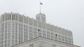 Old government building in Russia, tricolor flag is swaying. By wind on top stock video