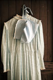 Old Gown Hanging on a Door Royalty Free Stock Image