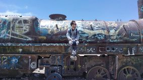 Old, graffiti, locomotive. Sitting on an abandoned locomotive in the train graveyard in Bolivia Stock Photo
