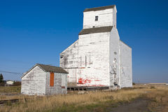 Old Grain Elevator. Old abandoned grain elevator on the Canadian prairies near the small town of Milden, Saskatchewan Royalty Free Stock Images