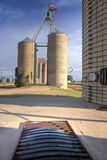 Old grain elevators next to railroad tracks Royalty Free Stock Images