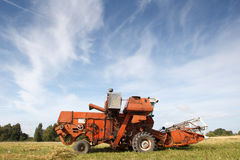 Old grain harvester Stock Photography