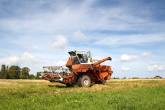 Old grain harvester Stock Images