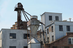 Old grain mill. Large abandoned old grain mill of yesteryear stock image