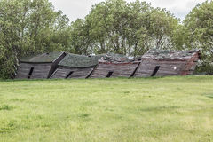 Old grain sheds. Leaning in a direction Stock Photo