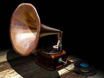 Old gramophone. An gramophone and some vinyl discs on a wood floor Stock Photography