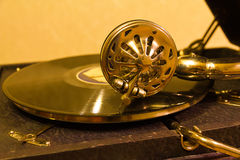Vintage sound. Old gramophone in gold tones stock photo