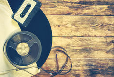 Old gramophone record, audio cassette, tape bobbin Royalty Free Stock Images