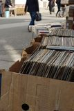Old gramophone records and books put on sale on street Stock Images
