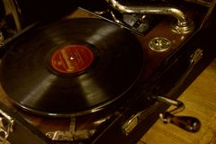 Old gramophone on table. Picture of a vintage gramophone Stock Photos
