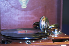 Old gramophone with vinyl disc. Old gramophone with reflection at vinyl disc Stock Photo