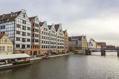 Old granaries by the river Motlawa in Gdansk, Poland Royalty Free Stock Photo