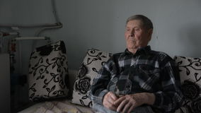 Old grandfather looking thoughtfully aside stock video footage