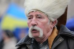 Old grandfather with a mustache in a papakha with a serious look. Street protests in Kiev, a Cossack in a papakha with a mustache, protesting. Old grandfather royalty free stock images