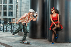 Old grandfather rushes on a skateboard. Royalty Free Stock Photos