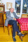 Old Grandfather sitting Royalty Free Stock Photography