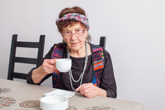Old grandmother drinking tea Royalty Free Stock Photography
