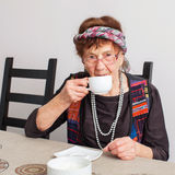 Old grandmother drinking tea. Granny woman at home. Mature female Royalty Free Stock Photography