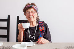 Old grandmother drinking tea Stock Image