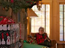 Old grandmother. senior lady enjoys mobile phone, smartphone at Christmas time royalty free stock images