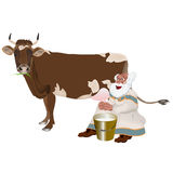 Old Grandpa milkman and a cow Stock Photography