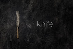 Old grange knife on concrete with text top view. Old grange knife on concrete with text stock photo