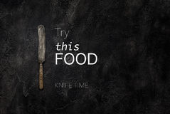 Old grange knife on concrete with text try this food top view Royalty Free Stock Photography
