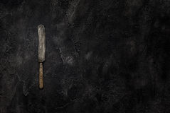 Old grange knife on concrete top view royalty free stock photo