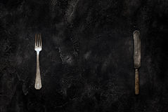 Old grange knife and fork on concrete top view Royalty Free Stock Photos
