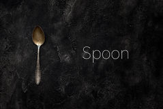 Old grange spoon with spoon on concrete top view stock image