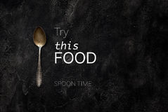 Old grange spoon with text try this food on concrete top view Stock Image