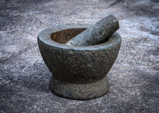 Old granite mortar with pestle Royalty Free Stock Photography
