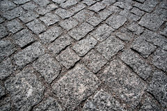 Old granite paving stones Royalty Free Stock Images