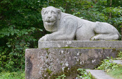 The old granite statue of a lion Royalty Free Stock Photo
