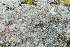 Old granite stone background with some moss. Old granite stone background with moss Royalty Free Stock Photos