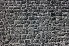 Old granite wall Stock Images