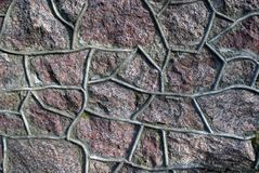 Old granite wall. Old granite stone wall with cement seam Stock Image