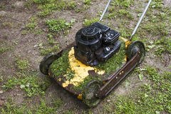 Old grass cutter Stock Images