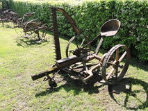 Old grass cutting machine. And  hay raking machine. Lithuania Royalty Free Stock Photos