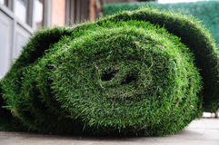 Old grass mat rolling prepare to proceed. Royalty Free Stock Image